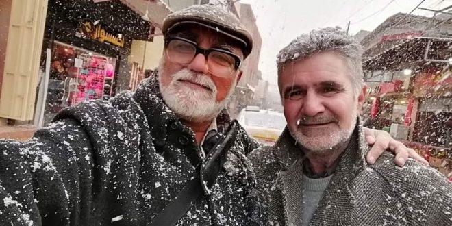 صورتان بورترية للفنان #أنور _الرويش والشاعر الفذ #كرم_ الأعرجي..أثناء تساقط الثلج في الموصل ..بتاريخ -10-2-2020م..